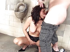She's a dirty whore and does everything a man asks her. Here she is, in an abandoned public toilet sucking this chap and then licking his anus before that guy bonks her from behind. She's a cougar that enjoys a good dirty fuck and probably will enjoy his semen too so stick with us and watch this wench in full act