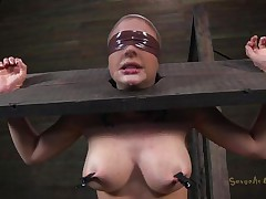 Clamps with weights were attached on her big boobs and duct tape was used to blindfold her. Now she stays there in that thraldom device and has a rodeo sex machine underneath her that's rubbing her shaved pussy. To make things interesting an executor comes and deeply mouth bonks this slut girl, chocking her with pecker
