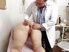 Yvonne is at gynecologist absolutely naked and waits for the doctor to examine her body. She's a bit bulky but that means there's a lot more to love as the doctor carefully and gently inserts a medical tool in her hot bald darksome gap and then this chab gapes her bald love tunnel looking inside her pink pussy, that cunt is perfect for a hard dick and maybe the doc will give her some fucking therapy.