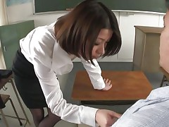 I stayed after hours to have a chat with me teacher Kaoru, damn she's a fine piece of ass and all the boys in the class want to nail her. Luckily Kaoru was insanely lascivious that time and this babe knelt in front of me, took out my cock and started to engulf it and the balls too. I filmed her and boy I'm proud of that!