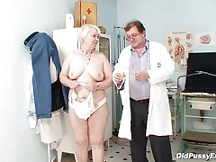 Bozena is a aged lady with big boobs, horny face and big ass. After doctor asks her to strip this dude is using a sucking machine to make her nipples harder. This doc has a messy mind and surely this dude is making her horny, who knows what tricks this dude has to make this old whore willing to fuck.