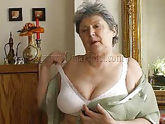 Granny takes off her shirt and bra and her heart rate increases as this babe starts massaging those large saggy boobs. Just like in her youth this fucking doxy takes off her clothes to pleasure men! Granny removes those white panties and reveals her saggy hairy cunt that she's enjoys rubbing. What she's up to next?