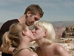 They are in the desert, the burning sun is upon 'em and made 'em insanely hot so they fuck like crazy, one chick licks the other ones fur pie and gets drilled in the rectal hole with a dildo. The blonde that is receiving a tongue in her fur pie is tied and lays on the sand, will the man cool her with some sperm?