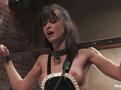 Cecilia Vega has a very hard to please boss in Princess Donna Dolore! Cecilia's hands are bound, this hottie has large beads in her pussy attached to wires, and is getting her little titties whipped! They're as red as Princess Donna's dress! After some more whipping, this hottie tells Cecilia to dust some more.