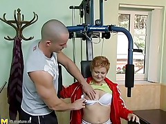 Watch this hawt red headed cougar who takes advantage of this young gym instructor. She has great sex experience and starts seducing him, like she well knows. This old playgirl has all she needs to make a man happy. She starts taking off her clothing to turn the young stud on. He can't live without playing with her tits.