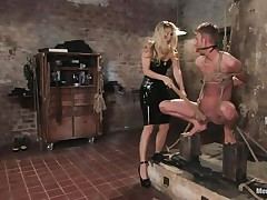That babe got her stud tied nice-looking nice and now she's having some joy with his body, paying a lot of special attention to his cock. This sexy bossy milf with blonde hair and fit body is using her tools to taunt and induce pain to her man. Look at her spanking his 10-Pounder and body as he's tied up and ball gagged.