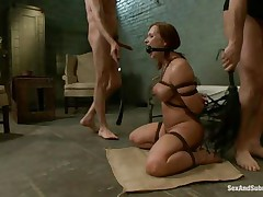 This brown hawt floozy is a prisoner of this 2 guys. This babe is naked and bounded and this babe sits on the floor and waits to be punished by these dudes with large cocks. One of them fucks her throat and after that he penetrates her wet vagina. The slut screams of pleasure and this babe is willing for a threesome.