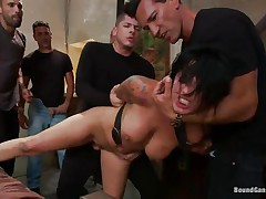 Eva Angelina is a white 27 years old american girl with a nice pair of mangos which has the bad luck to be surrounded by five concupiscent guys who like coarse fucking. They test her mouth size by inserting their dicks so deep until she can't even breathe. Next, they widen her legs and alternative fuck her