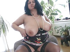 This chubby mature is going insane and definitely in need of some masturbation. So with out wasting any time this babe is revealing her huge meatballs and crushing them to make her pussy wet. After this babe is rubbing her pussy and fingering it. As soon as is becomes wet this babe is licking her love juice through her hands.