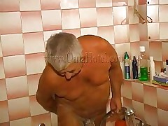 The old fart is taking a shower when his woman comes to help him wash. They may be old but they still have some excitement for each other and soon a easy shower turns into a shower fuck! The granny takes off her garments and joins him and he begins rubbing and soaping those saggy tits and then rub her pussy.