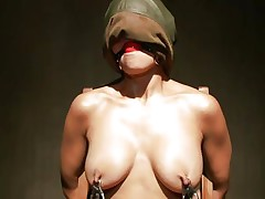 Hot Beretta sits on a chair with her hands fastened up and is face hole gagged. With her nipples tortured, her executor moves to her miniature cunt and puts a pump on it to suck it all in. The doxy groans with pleasure, while he sticks a dildo on her juicy cunt and grabs her nipples a little. This is so hot!