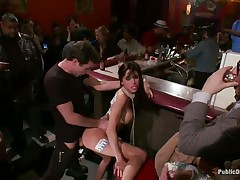 Gia DiMarco is on a rope leash, getting fucked in the wazoo right in the midst of the bar while the patrons watch. This babe continuously thanks James Deen for fucking her ass. Then she's on the floor, getting fingered by a woman, squirting all over. This babe mops up the mess with Gia's hair, then fists her.