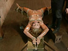 Blonde slut Cameron is all tied up with strings to a wooden table and face aperture gagged. With her legs spread, that babe gets fingered and has a sex tool on her clitoris. Let`s take a close look at that hawt oiled up body and with wax all over her! Will her goddess make that wench cum if her cunt gets fisted so hard?
