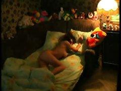 Juvenile teen in bed rubbing her fur pie